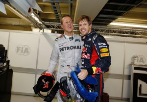 Michael Schumacher congratulates Sebastian Vettel on his third title in 2012 © Daimler