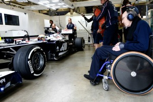 Pastor Maldonado in the Williams pit garage with Sir Frank Williams looking on (Glenn Dunbar/Williams F1)