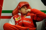 Kimi Raikkonen relaxes in the Ferrari pit garage (Image: Ferrari)